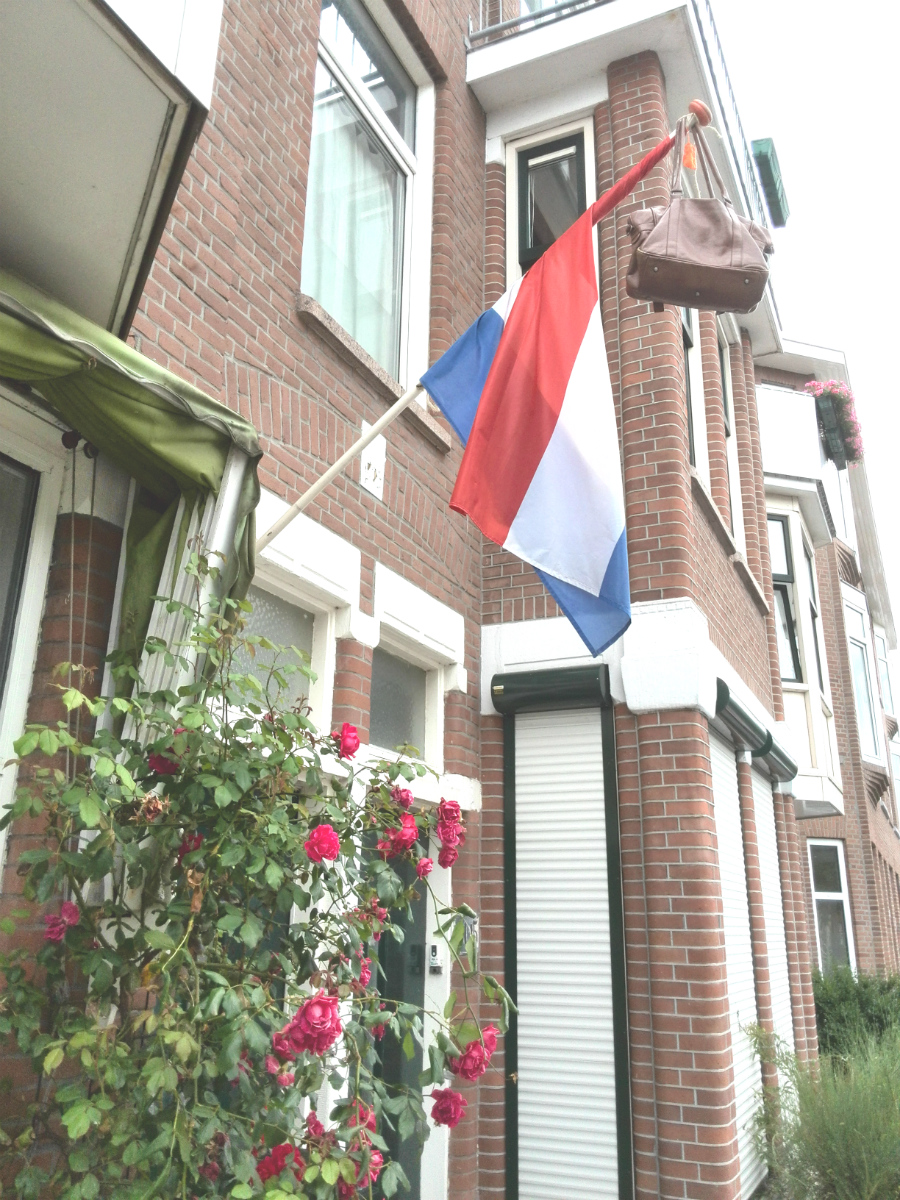 A Dutch flag with a school bag at the end of the pole to denote a student who has passed their exams.